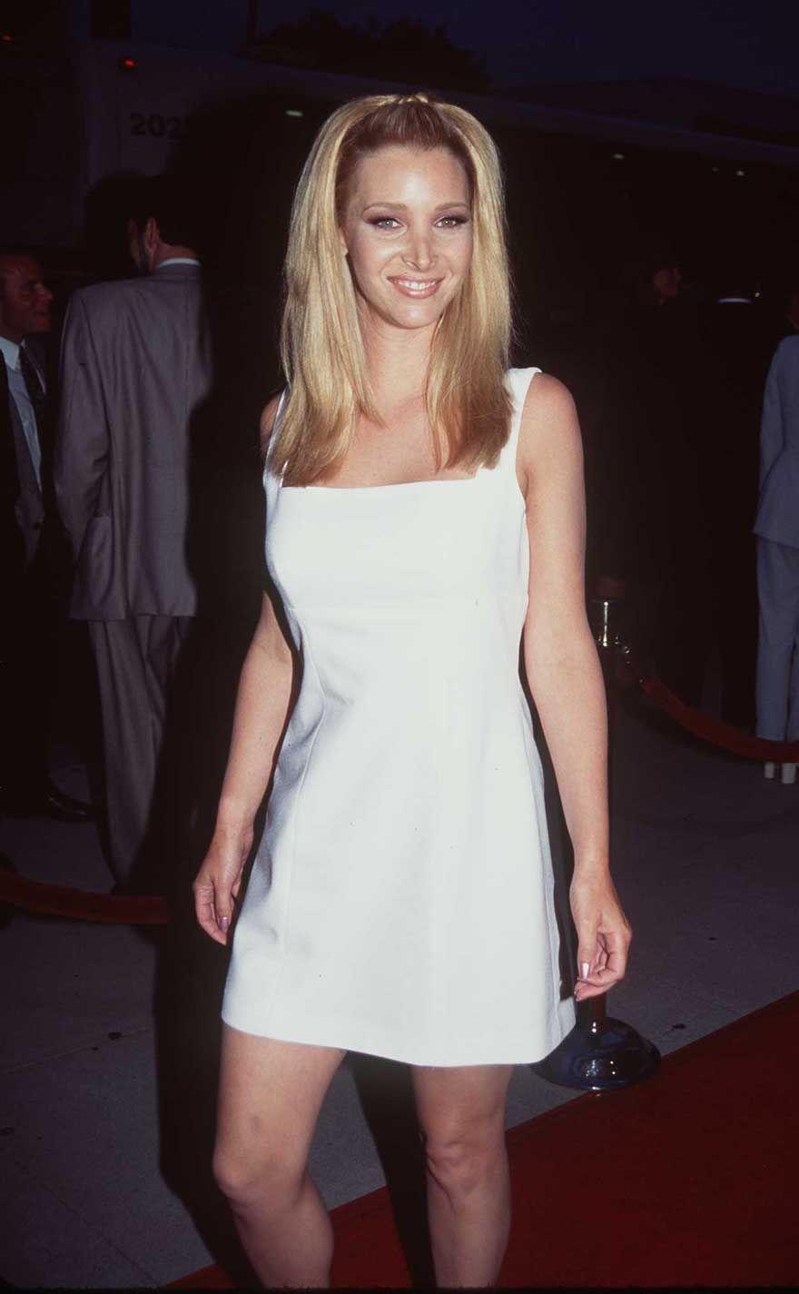 <p>Lisa Kudrow looks like a total bombshell from her hair to the white dress seen at the HBO premiere of <em>Norma Jean & Marilyn</em> in 1996. </p>