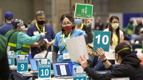 PHOTO: Staff and volunteers work vaccination stations during opening day of the Community Vaccination Site at the Lumen Field Event Center in Seattle, on March 13, 2021. (Jason Redmond/AFP via Getty Images, FILE)