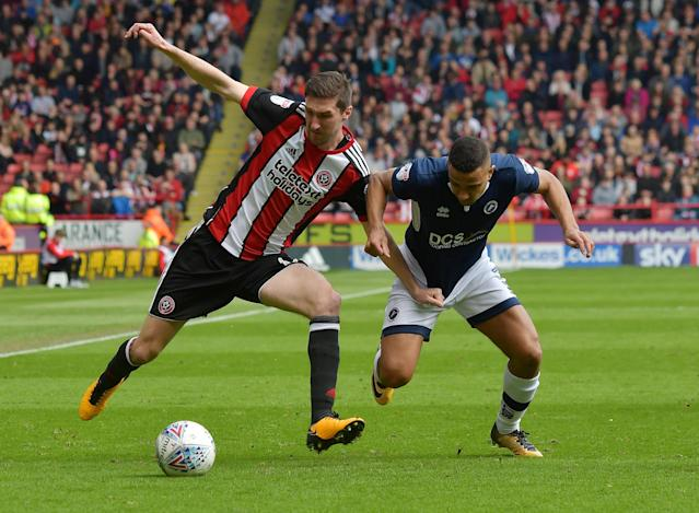 "Soccer Football - Championship - Sheffield United vs Millwall - Bramall Lane, Sheffield, Britain - April 14, 2018 Sheffield United's Chris Basham in action with Millwall's James Meredith Action Images/Paul Burrows EDITORIAL USE ONLY. No use with unauthorized audio, video, data, fixture lists, club/league logos or ""live"" services. Online in-match use limited to 75 images, no video emulation. No use in betting, games or single club/league/player publications. Please contact your account representative for further details."