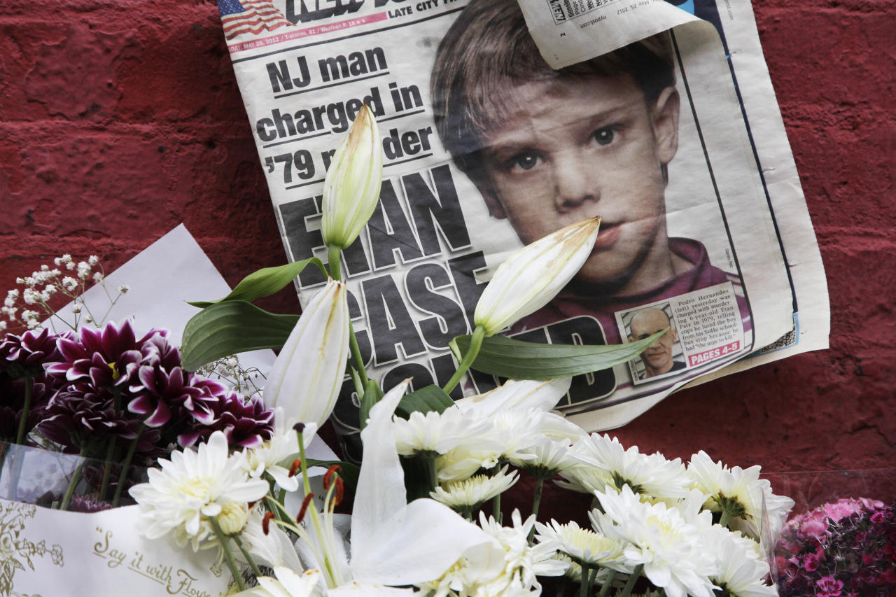 A newspaper with a photograph of Etan Patz is part of a makeshift memorial in the SoHo neighborhood of New York, Monday, May 28, 2012. For prosecutors, the work is just beginning after the astonishing arrest last week of a man who police say confessed to strangling the 6-year-old New York City boy 33 years ago in one of the nation's most bewildering missing children's cases. Pedro Hernandez, 51, was charged with second-degree murder in the 1979 death of Etan Patz, based largely on a signed confession he gave to detectives. (AP Photo/Mark Lennihan)