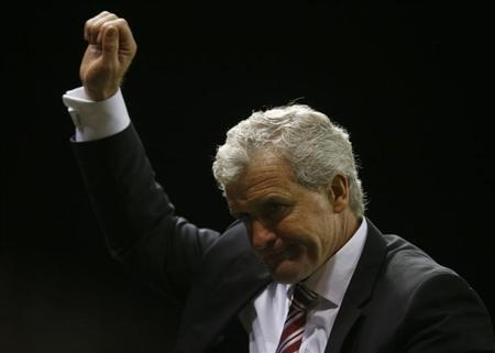 Stoke City manager Mark Hughes celebrates after his side beat Chelsea in their English Premier League soccer match at the Britannia Stadium in Stoke-on-Trent, central England, December 7, 2013. REUTERS/Andrew Winning