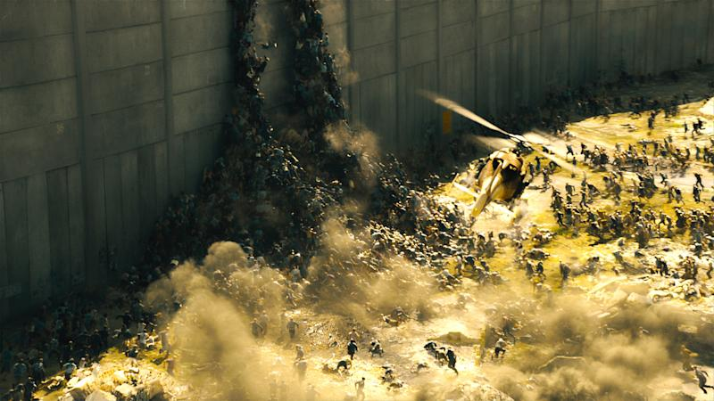 "This publicity image released by Paramount Pictures shows a scene from ""World War Z."" The zombies in ""World War Z"" move with Carl Lewis speed and a swarm-like mentality inspired in part by rabid dogs, furthering the eternal fan debate over whether the walking dead should actually run. (AP Photo/Paramount Pictures)"