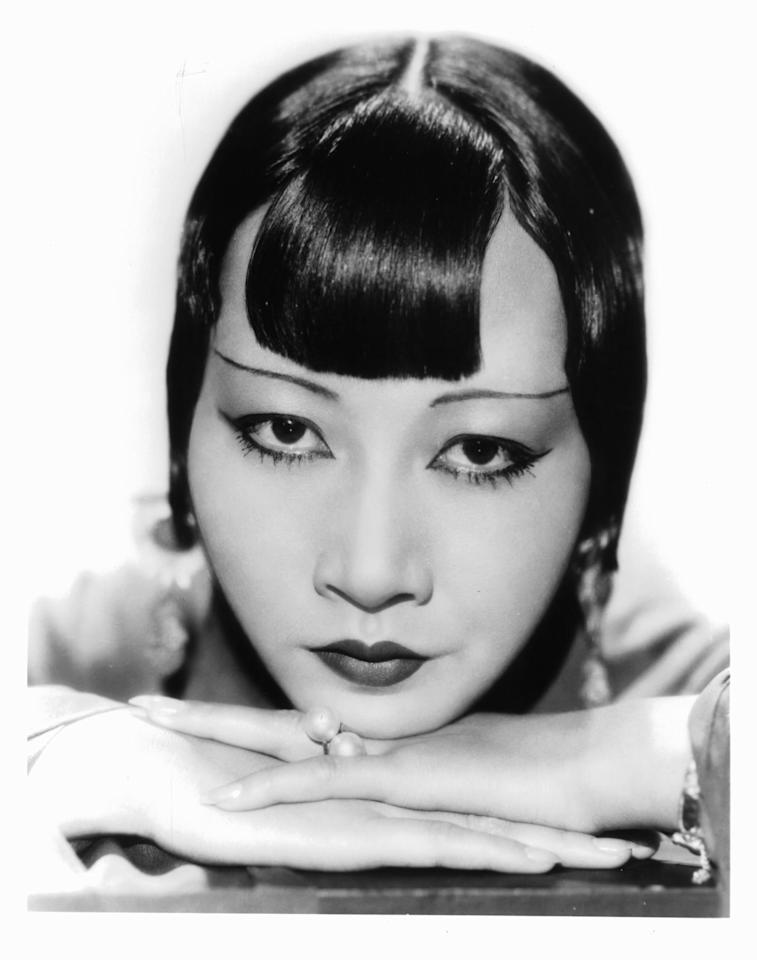 """<p>Anna May Wong is considered the first Chinese-American Hollywood movie star,<sup class=""""reference""""><a href=""""https://en.wikipedia.org/wiki/Anna_May_Wong#cite_note-1"""" a="""""""" target=""""_blank"""" class=""""ga-track"""" data-ga-category=""""internal click"""" data-ga-label=""""https://en.wikipedia.org/wiki/Anna_May_Wong#cite_note-1"""" data-ga-action=""""body text link""""></a></sup> as well as the first Chinese-American actress to gain international recognition. During the silent film era, Wong gained fame through films such as <strong>The Toll of the Sea</strong> and<strong> The Thief of Baghdad</strong>, and in 1951, the actress made history with her TV show <strong>The Gallery of Madame Liu-Tsong</strong>, which was the first TV show in the US with an Asian-American series lead.</p>"""