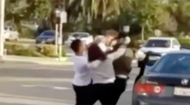 PICTURED: A group of people caught in a road rage fight. Photo: Channel 7