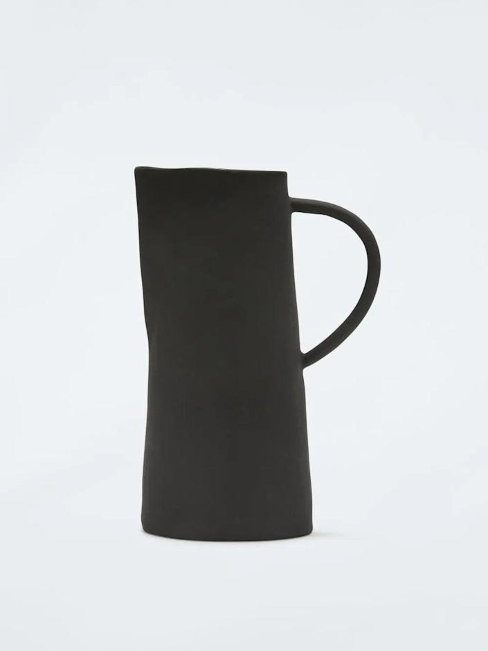 """Fashion and lifestyle brand Off-White is behind this striking ceramic water jug. We're charmed by its slender handle, matte finish, and slim, slightly off-kilter shape. $210, Off White. <a href=""""https://www.off---white.com/en-us/shopping/off-white-irregular-black-matte-jug-15902750"""" rel=""""nofollow noopener"""" target=""""_blank"""" data-ylk=""""slk:Get it now!"""" class=""""link rapid-noclick-resp"""">Get it now!</a>"""