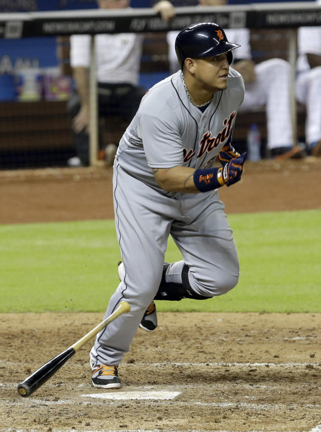 Detroit Tigers' Miguel Cabrera heads to first base after hitting his second base hit against the Miami Marlins in the fifth inning of an interleague baseball game on Saturday, Sept. 28, 2013, in Miami. Torii Hunter reached second base on the single. (AP Photo/Alan Diaz)