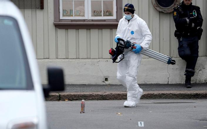 Police work near a site after a man killed some people in Kongsberg, Norway - NTB