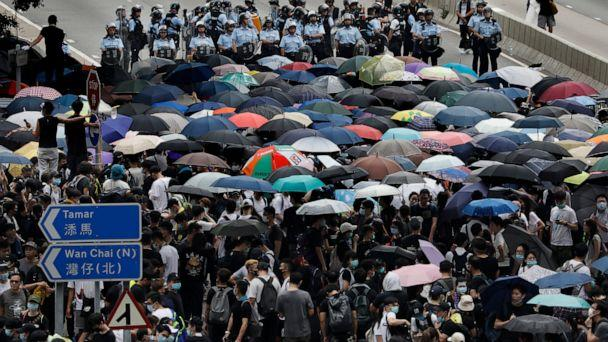 PHOTO: Protesters gather outside the Legislative Council in Hong Kong, Wednesday, June 12, 2019. (AP Photo/Vincent Yu)