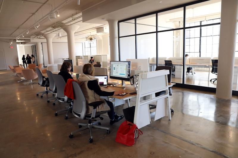 Members working in the offices of HudCo, a co-working space that blends work, life and well-being in Dobbs Ferry, March 13, 2019.