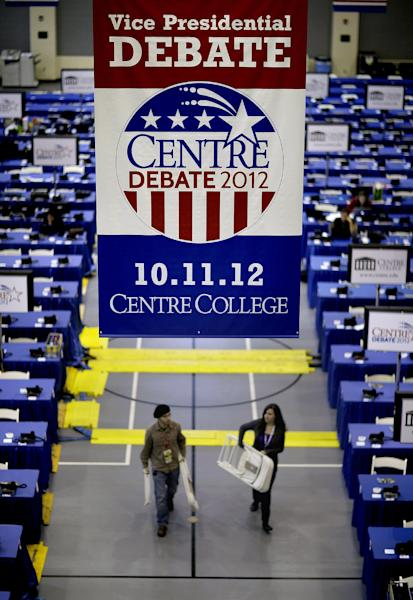 Workers carry chairs through the media center ahead of Thursday's vice presidential debate Wednesday, Oct. 10, 2012, at Centre College in Danville, Ky. (AP Photo/David Goldman)