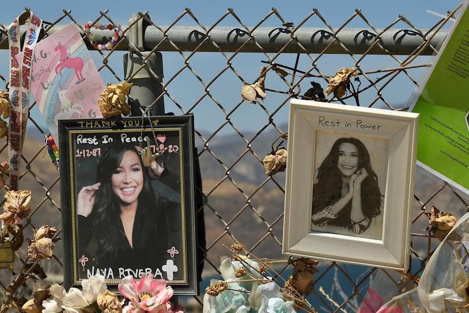 PIRU, CALIFORNIA - AUGUST 03:  A memorial set up by fans to honor actress Naya Rivera at Lake Piru, where Rivera's death was ruled an accidental drowning, on August 3, 2020 in Piru, California. Rivera was declared missing July 8 after her four-year-old son, Josey, was found alone on a boat she had rented. Her body was recovered by search and rescue workers at Lake Piru on July 13.  (Photo by Amy Sussman/Getty Images)