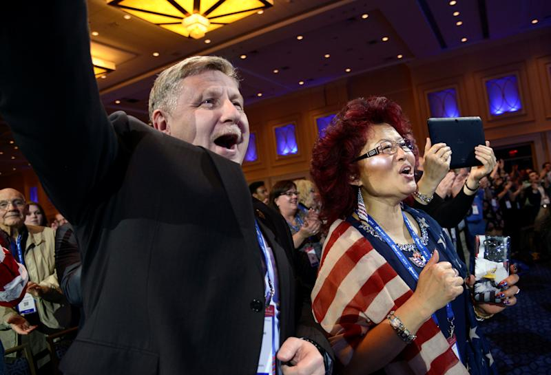 Rick Saccone attends the Conservative Political Action Conference with his wife Yong in February 2017. Democrats hope Saccone's disagreements with labor unions prove to be a weakness. (Mike Theiler / Reuters)
