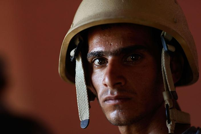 """<p>A member of the Iraqi military police is seen during patrol June 17, 2007 in the tense Dora neighborhood of Baghdad, Iraq. The Iraqi MPs were on a joint patrol with the US Army's 1st Squad, 4th Cavalry Regiment as part of the """"surge"""" in troops that is now attempting to pacify Baghdad and move the city's warring factions toward political compromise. (Photo by Chris Hondros/Getty Images) </p>"""