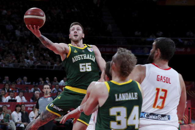 Mitch Creek of Australia puts a shot over Spain during their semifinals match for the FIBA Basketball World Cup at the Cadillac Arena in Beijing, Saturday, Sept. 13, 2019. (AP Photo/Andy Wong)