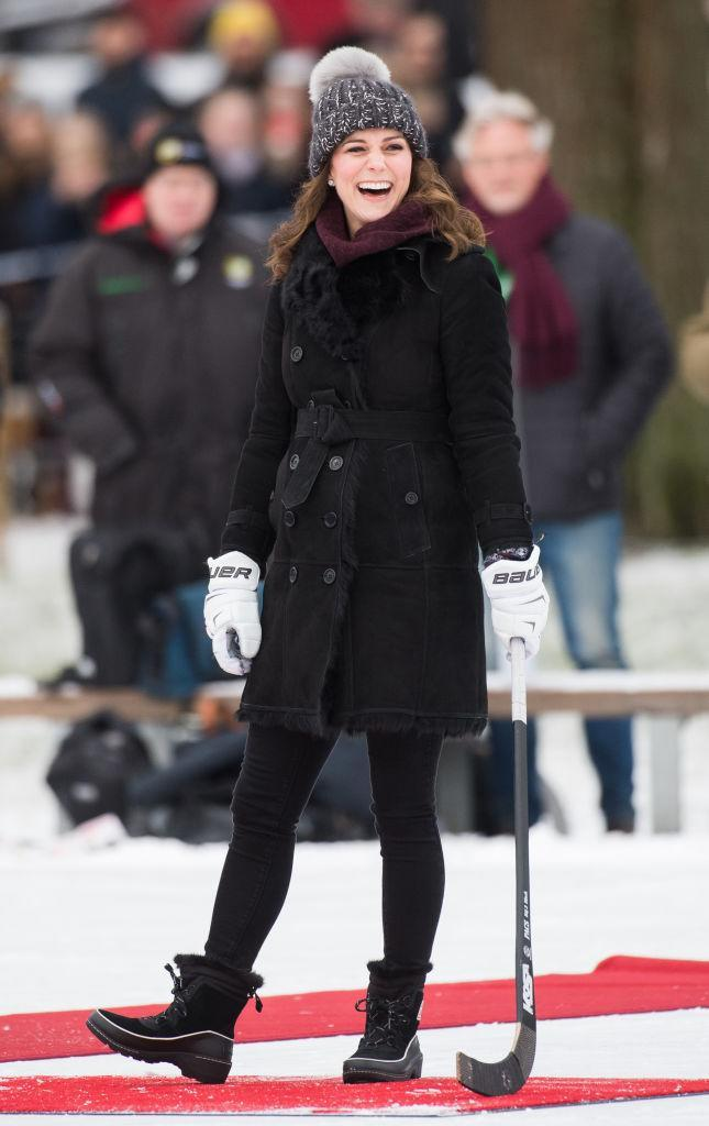 <p>The Duchess of Cambridge donned a shearling coat by Burberry with Sorel snow boots for the first day in Stockholm. She finished the look with a burgundy jumper by Swedish label, Fjällräven and a faux fur bobble hat from Eugenia Kim (FYI, it sold out instantly).<em> [Photo: Getty]</em> </p>