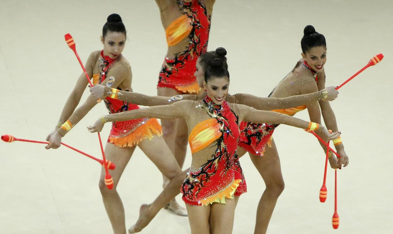 Members of Spain's team perform during the group 10 clubs competition final at the 32nd Rhythmic Gymnastics World Championships in Kiev September 1, 2013. REUTERS/Gleb Garanich (UKRAINE - Tags: SPORT GYMNASTICS)