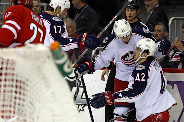 Columbus Blue Jackets' Artem Anisimov (42) of Russia, is congratulated on his goal by teammate Cam Atkinson (13) and Brandon Dubinsky (17) during the first period of an NHL hockey game against the Carolina Hurricanes in Raleigh, N.C., Monday, Dec. 23, 2013. Columbus won 4-3. (AP Photo/Karl B DeBlaker)