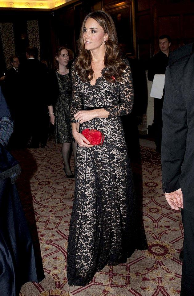 Also looking lovely this week was Catherine, Duchess of Cambridge, who garnered oohs and aahs upon arriving at a recent charity dinner in this lacy long-sleeved gown -- courtesy of Temperley London. A bow-adorned Alexander McQueen clutch and sophisticated diamond earrings made for the perfect accessories. (11/8/2012)