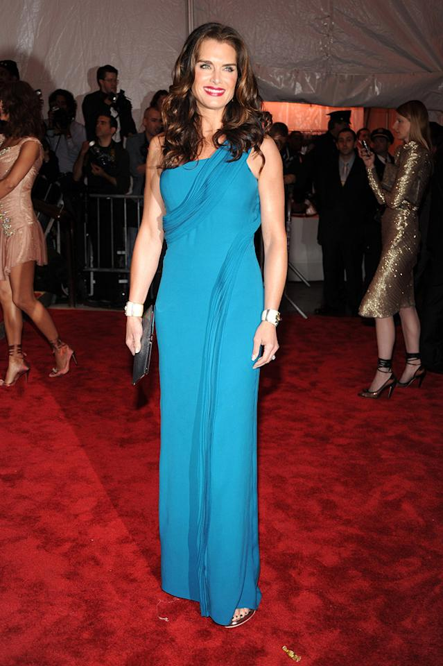 "Brooke Shields stole the spotlight at this year's MET Costume Gala in a sexy yet sophisticated turquoise column gown courtesy of Calvin Klein. Still flawless at 43! Kevin Mazur/<a href=""http://www.wireimage.com"" target=""new"">WireImage.com</a> - May 4, 2009"