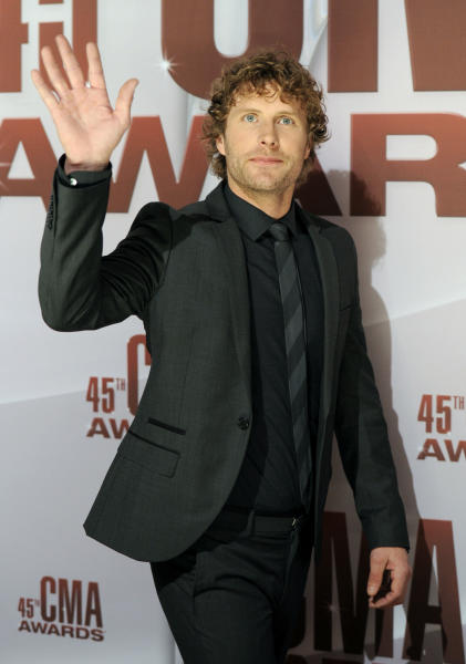 "FILE - This Nov. 9, 2011 file photo shows country singer Dierks Bentley at the 45th Annual CMA Awards in Nashville, Tenn. Bentley is releasing a new four-song EP called ""Country & Cold Cans"" even while his last album continues to chart hit singles. (AP Photo/Evan Agostini, file)"