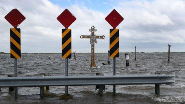 PHOTO: A cross honoring those killed by Hurricane Katrina stands in the Mississippi River-Gulf Outlet before the possible arrival of Hurricane Sally on Sept. 14, 2020, in Shell Beach, La. (Joe Raedle/Getty Images)
