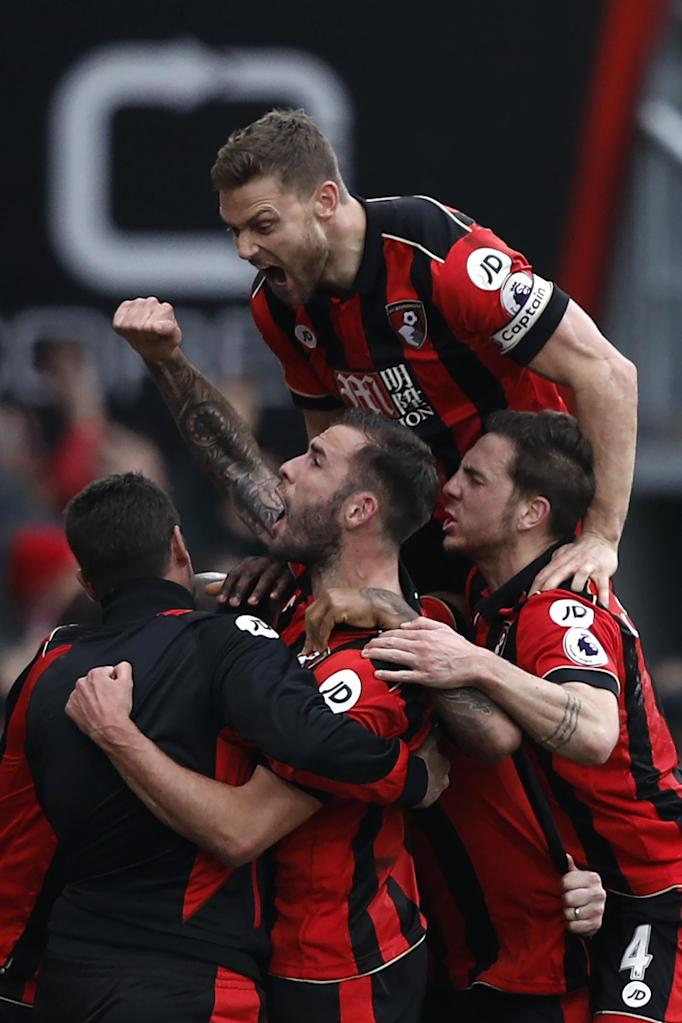 Bournemouth players celebrate on the touchline with manager Eddie Howe after Joshua King scores his third goal to give Bournemouth a 3-2 against West Ham on March 11, 2017