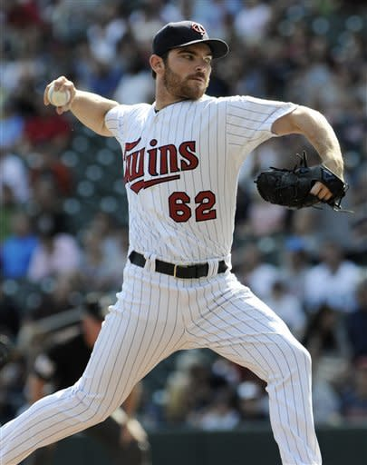 Minnesota Twins pitcher Liam Hendriks throws against the Detroit Tigers in the first inning of a baseball game Sunday, Sept. 30, 2012 in Minneapolis. (AP Photo/Jim Mone)