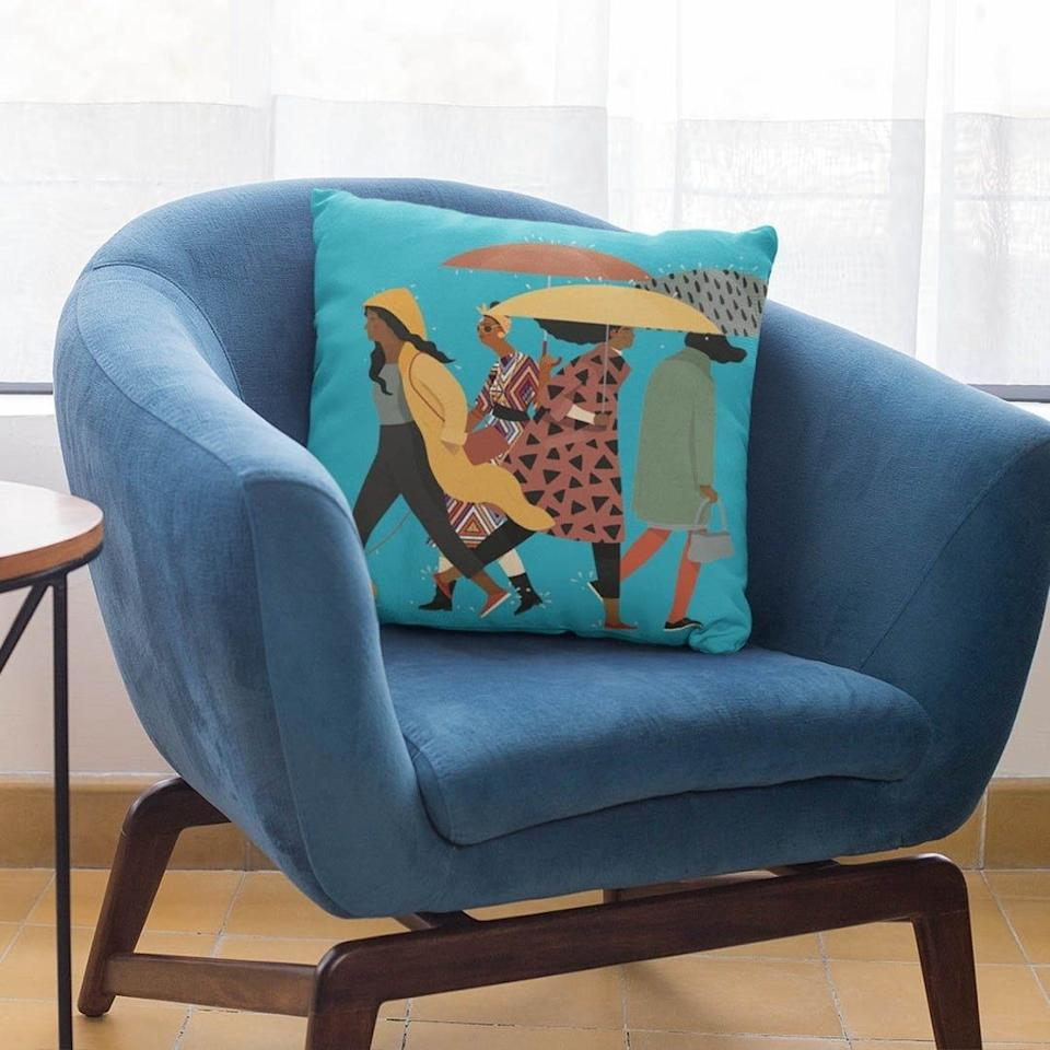 """Give your lonely sofa a conversation-starting centerpiece. Rainy day or not, you'll love to see this sitting there.<br /><br />BTW — This Black- and woman-owned small business is based in Houston, Texas. The shop has some amazing decorative pillows!<br /><br /><strong>Get it from<a href=""""https://www.awin1.com/cread.php?awinmid=6220&awinaffid=837483&clickref=HPHomeMagazine-609acebfe4b099ba752f64c2-&ued=https%3A%2F%2Fwww.etsy.com%2Fshop%2Fthetrinigee"""" target=""""_blank"""" rel=""""nofollow noopener noreferrer"""" data-skimlinks-tracking=""""5854435"""" data-vars-affiliate=""""AWIN"""" data-vars-campaign=""""SHOPMagazineHomeMower2-2-2021--5854435-"""" data-vars-href=""""https://www.awin1.com/cread.php?awinmid=6220&awinaffid=304459&clickref=SHOPMagazineHomeMower2-2-2021--5854435-&ued=https%3A%2F%2Fwww.etsy.com%2Fshop%2Fthetrinigee"""" data-vars-link-id=""""16331379"""" data-vars-price="""""""" data-vars-product-id=""""20945930"""" data-vars-product-img="""""""" data-vars-product-title="""""""" data-vars-retailers=""""etsy"""" data-ml-dynamic=""""true"""" data-ml-dynamic-type=""""sl"""" data-orig-url=""""https://www.awin1.com/cread.php?awinmid=6220&awinaffid=304459&clickref=SHOPMagazineHomeMower2-2-2021--5854435-&ued=https%3A%2F%2Fwww.etsy.com%2Fshop%2Fthetrinigee"""" data-ml-id=""""24"""">The Trini Gee</a>on Etsy for<a href=""""https://www.awin1.com/cread.php?awinmid=6220&awinaffid=837483&clickref=HPHomeMagazine-609acebfe4b099ba752f64c2-&ued=https%3A%2F%2Fwww.etsy.com%2Flisting%2F931767957%2Frainy-day-pillow-black-women-art-african"""" target=""""_blank"""" rel=""""nofollow noopener noreferrer"""" data-skimlinks-tracking=""""5854435"""" data-vars-affiliate=""""AWIN"""" data-vars-campaign=""""SHOPMagazineHomeMower2-2-2021--5854435-"""" data-vars-href=""""https://www.awin1.com/cread.php?awinmid=6220&awinaffid=304459&clickref=SHOPMagazineHomeMower2-2-2021--5854435-&ued=https%3A%2F%2Fwww.etsy.com%2Flisting%2F931767957%2Frainy-day-pillow-black-women-art-african"""" data-vars-link-id=""""16331377"""" data-vars-price="""""""" data-vars-product-id=""""20945822"""" data-vars-product-img=""""https://i.etsystatic.com/16392738/r/il/43f43"""