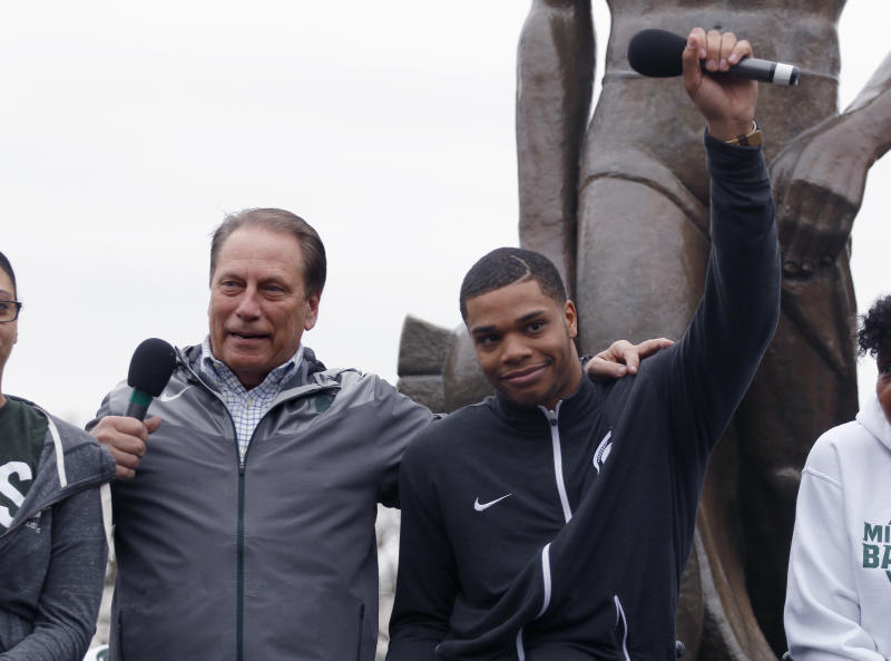 Michigan State's Miles Bridges, right, and men's basketball coach Tom Izzo speak during an NCAA college basketball news conference, Thursday, April 13, 2017, in East Lansing, Mich. Bridges, a 6-foot-7 forward from Flint, Mich., announced he is returning for his sophomore season. (AP Photo/Al Goldis)