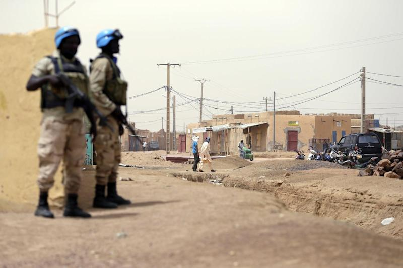 United Nations soldiers patrol on July 27, 2013 in the northern Malian city of Kidal (AFP Photo/Kenzo Tribouillard)