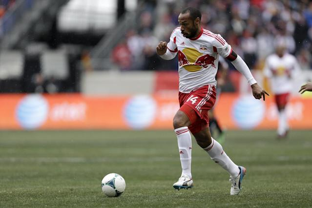 New York Red Bulls forward Thierry Henry dribbles the ball during the first half of an MLS soccer game against the D.C. United, Saturday, March 16, 2013, in Harrison, N.J. (AP Photo/Julio Cortez)