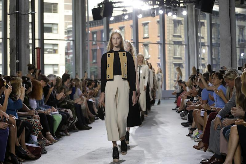 The Proenza Schouler Spring 2014 collection is modeled during Fashion Week in New York, Wednesday, Sept. 11, 2013. (AP Photo/Seth Wenig)