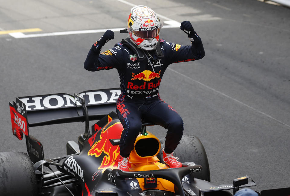 Red Bull driver Max Verstappen of the Netherlands celebrates on his car after winning the Monaco Grand Prix at the Monaco racetrack, in Monaco, Sunday, May 23, 2021. (Gonzalo Fuentes, Pool via AP)