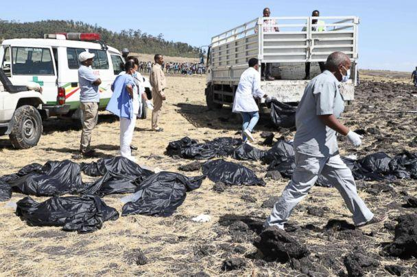 PHOTO: Rescue teams walk past collected bodies in bags at the crash site of Ethiopia Airlines near Bishoftu, southeast of Addis Ababa, Ethiopia, March 10, 2019. (Michael Tewelde/AFP/Getty Images)