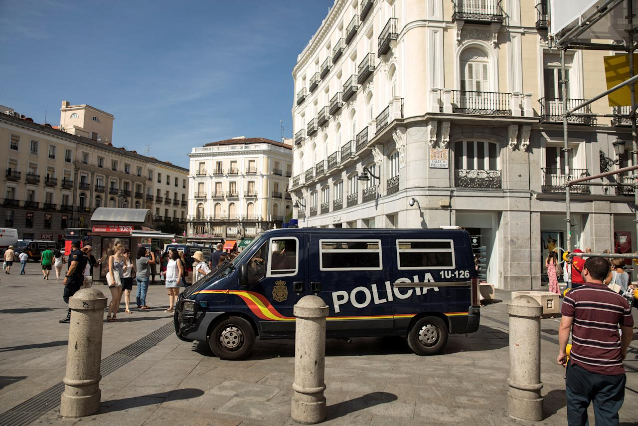 A police van drives by at Madrid's Puerta del Sol square, Spain, August 18, 2017. REUTERS/Juan Medina