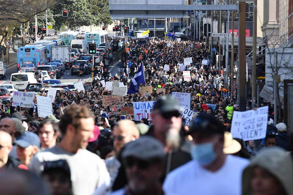 Anti lockdown protesters march along Broadway and George St in Sydney on Saturday.