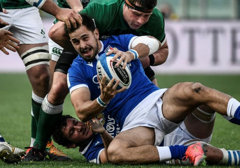 Ireland flanker Cj Stander (Top) tackles Italy wing Mattia Bellini (C) in Rome.