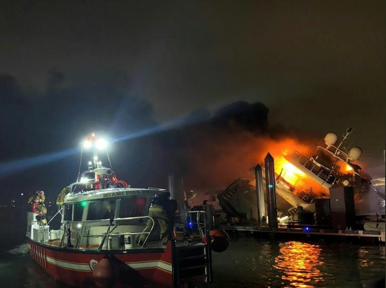 Miami firefighters struggled for two hours to douse the flames that destroyed a luxury yacht belonging to Latin singer Marc Anthony (AFP Photo/HO)