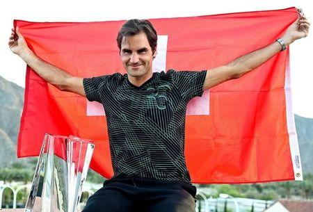Mar 19, 2017; Indian Wells, CA, USA; Roger Federer (SUI)  poses with the championship trophy after defeated Stan Wawrinka (not pictured) 7-6, 6-4 in the men's final in the BNP Paribas Open at the Indian Wells Tennis Garden. Mandatory Credit: Jayne Kamin-Oncea-USA TODAY Sports