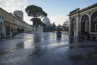 A Vatican Museum worker drives a cleaning machine on a terrace of the Vatican Museums as they prepare to open, at the Vatican, Monday, Feb. 1, 2021. . The Vatican Museums reopened Monday to visitors after 88 days of shutdown following COVID-19 containment measures. (AP Photo/Andrew Medichini)