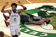 Brooklyn Nets guard Kyrie Irving (11) gestures after fouling Boston Celtics guard Marcus Smart (36) who celebrates his 3-point basket during the third quarter of Game 3 of an NBA basketball first-round playoff series Friday, May 28, 2021, in Boston. (AP Photo/Elise Amendola)
