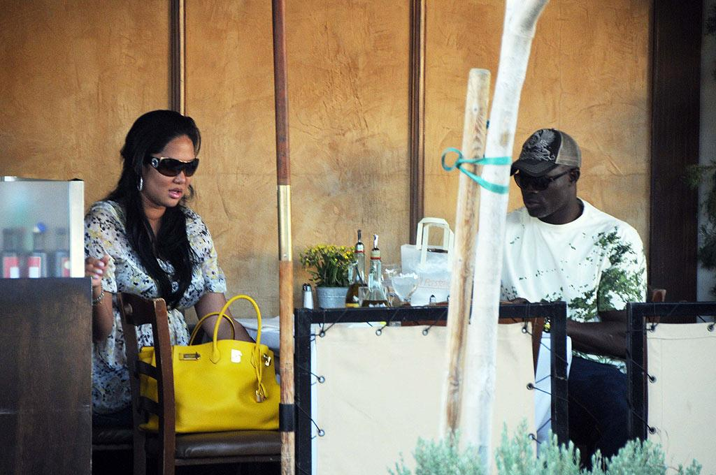 """Kimora Lee Simons dined al fresco with boyfriend Djimon Hounsou on Wednesday. A source close to the couple revealed that the supermodel-turned-entrepreneur is expecting their first child. <a href=""""http://www.infdaily.com"""" target=""""new"""">INFDaily.com</a> - January 14, 2009"""