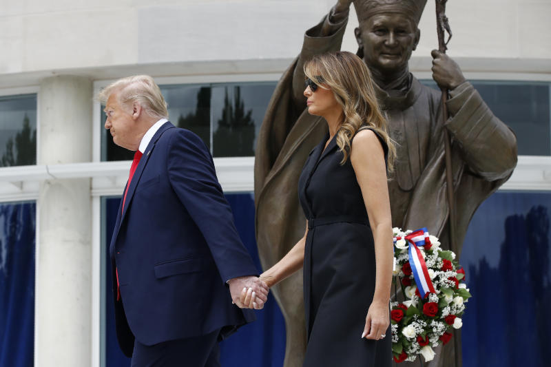 President Donald Trump and first lady Melania Trump depart after visiting Saint John Paul II National Shrine, Tuesday, June 2, 2020, in Washington. (AP Photo/Patrick Semansky)