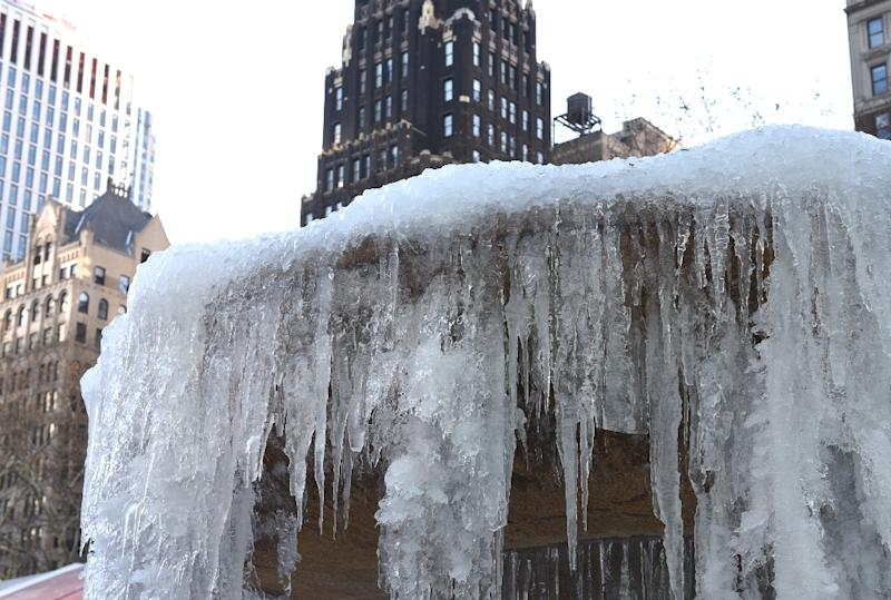 The frozen Josephine Shaw Lowell Memorial Fountain at Bryant Park in New York is seen on January 2, 2018, ahead of a winter storm watch with several inches of snow expected