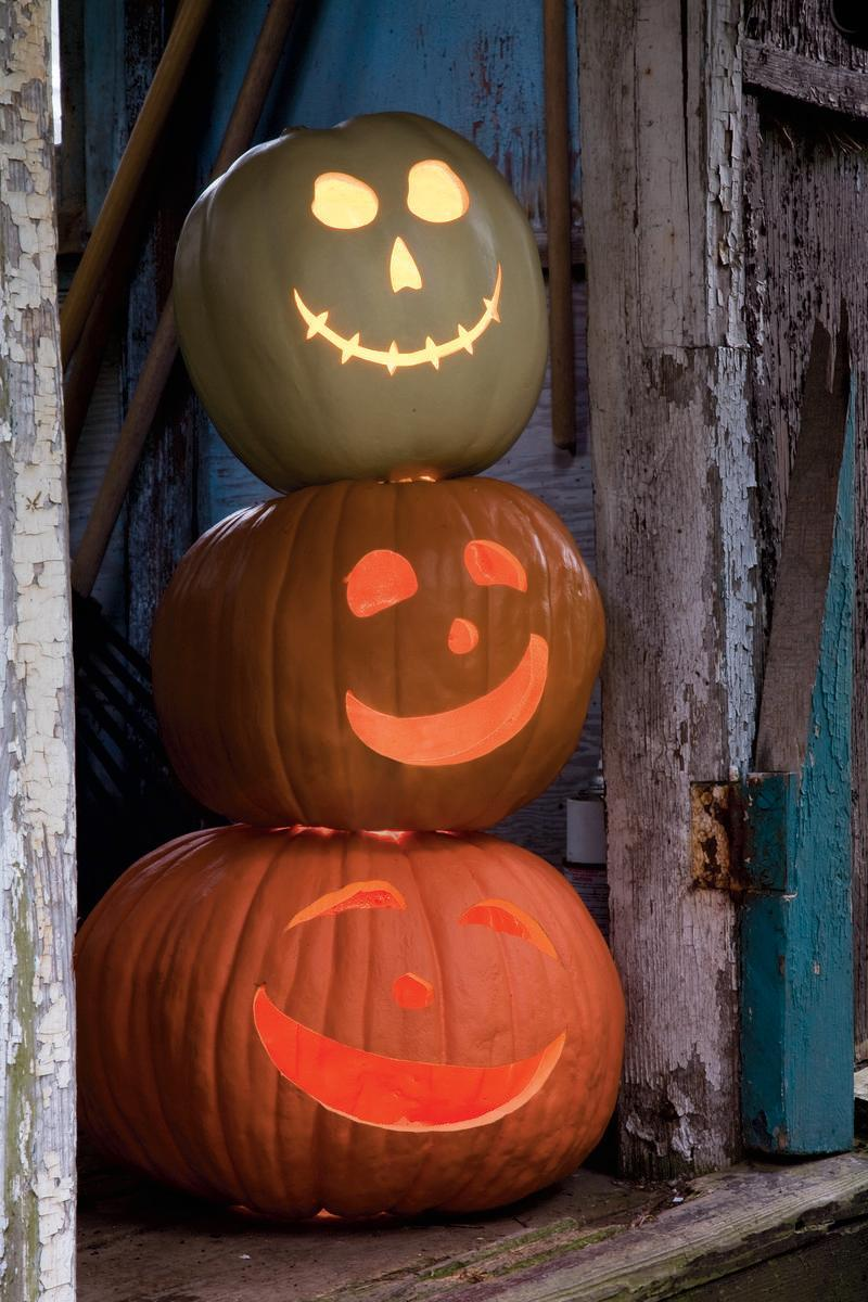 "<p>Carve holes on the tops and bottoms of each pumpkin to let light pass through them, so you don't have to use multiple candles or lights.</p><p><em><strong><a href=""https://www.womansday.com/home/crafts-projects/a28637128/jack-stack/"" rel=""nofollow noopener"" target=""_blank"" data-ylk=""slk:Get the Jack Stack tutorial."" class=""link rapid-noclick-resp"">Get the Jack Stack tutorial.</a></strong></em></p>"