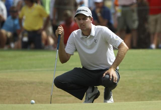 FILE PHOTO: Todd of the U.S. lines up a birdie putt on the seventh green during the second round of the U.S. Open Championship in Pinehurst