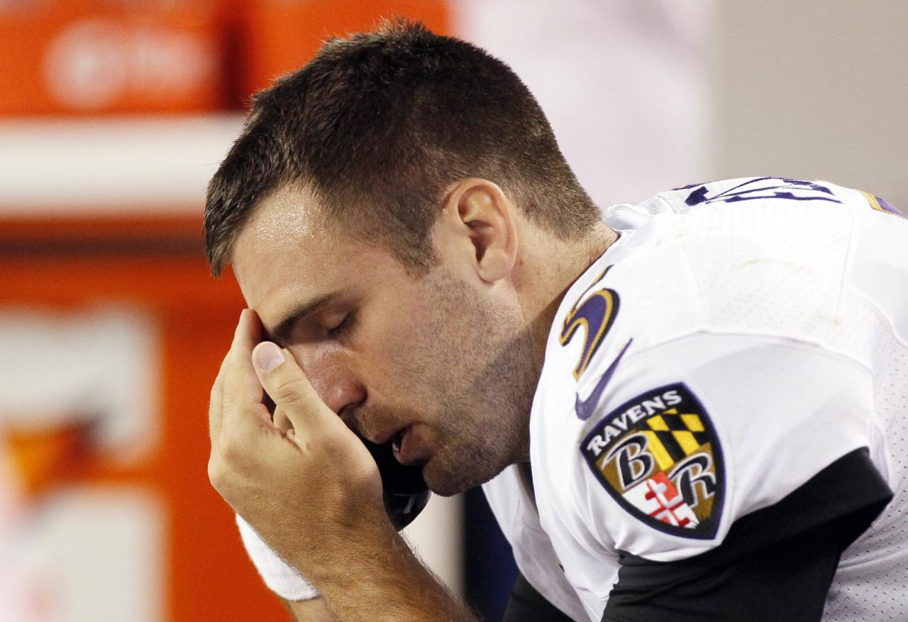 Baltimore Ravens quarterback Joe Flacco talks on the phone on the sidelines in the fourth quarter of their NFL football game against the Denver Broncos in Denver September 5, 2013. REUTERS/Rick Wilking (UNITED STATES - Tags: SPORT FOOTBALL)