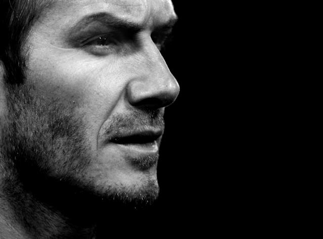 File photo dated 11/01/2009 of AC Milan's David Beckham on his debut against Roma.