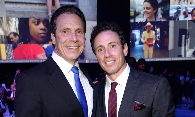 Andrew Cuomo with his brother Chris, right, who has tested positive for Covid-19.