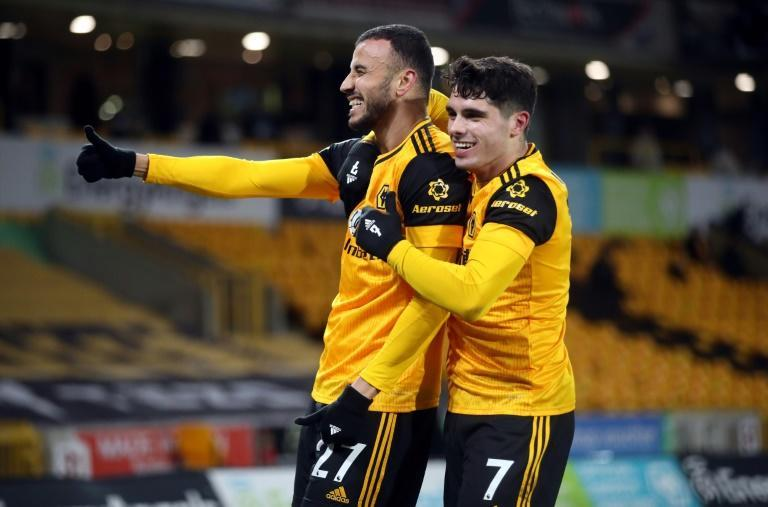 Romain Saiss (left) scored Wolves' late equaliser in a 1-1 draw with Tottenham